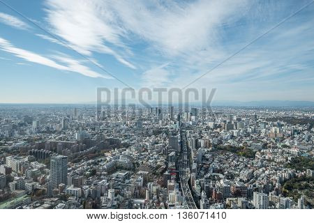 Tokyo Japan - November 21 2015:View of Tokyo city view from Mori Tower in the Kanto region and Tokyo prefecture Japan the first largest metropolitan area in Japan. Downtown Tokyo is very modern with many skyscrapers.