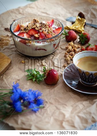 A delicious breaksfast with strawberry cereal and coffee