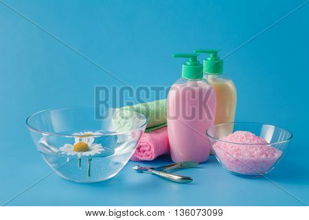 towel blue table with liquid soap and salt
