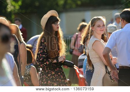 Orel Russia - June 24 2016: Turgenev Fest. Girl with long hair in hat and spectacles horizontal