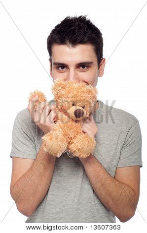 man cuddling a teddy