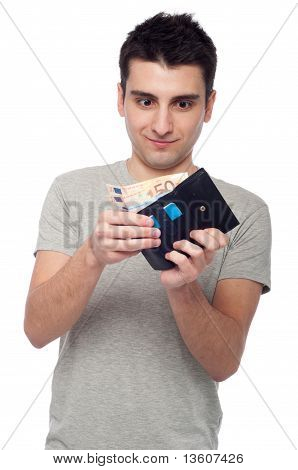 man looking at his wallet