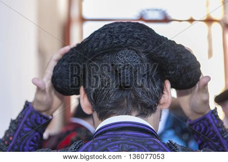 Andujar Spain - September 10 2011: Detail of Pigtail in the XIX century the bullfighters were left to grow a ponytail that braided in a bun called moña vague recollection of the times of the wigs of the XVIII century in the Bullring of Andujar Spain