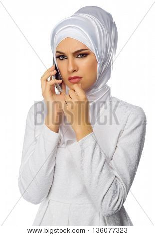 Muslim woman with mobile phone isolated