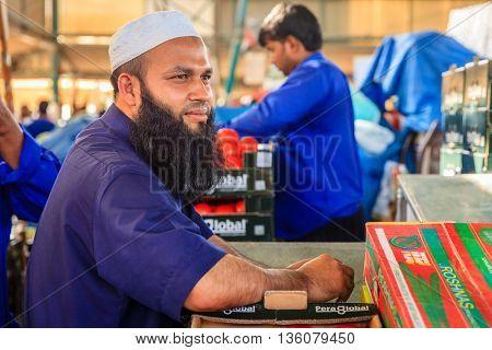 Dubai, June 4, 2016: portrait of local vendor at the fruit and vegetable market in Dubai, UAE