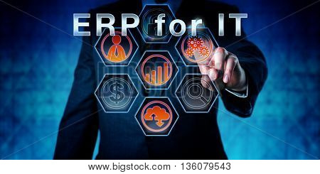 Businessman in dark blue suit is touching ERP for IT on an interactive virtual control monitor. Business terminology and acronym meaning Enterprise Resource Planning for Information Technology.