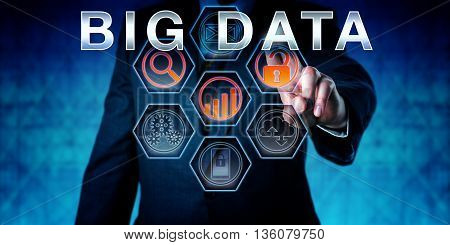 Male corporate manager is pushing BIG DATA on an interactive virtual touch screen interface. Business metaphor involving data management technology forecasting and transaction processing.