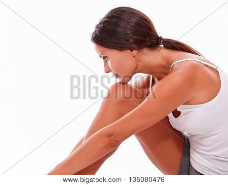Attractive Thoughtful Brunette Young Woman Sitting