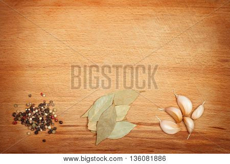 Spices on wooden framed background with empty space. Vibrant warm colors
