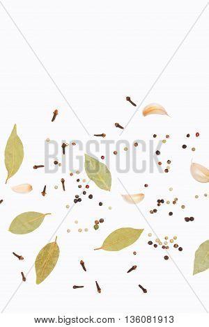 Clove paprika garlic and bay leaf  background