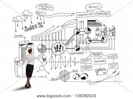 Rear view of businesswoman isolated on white background drawing business plan sketches