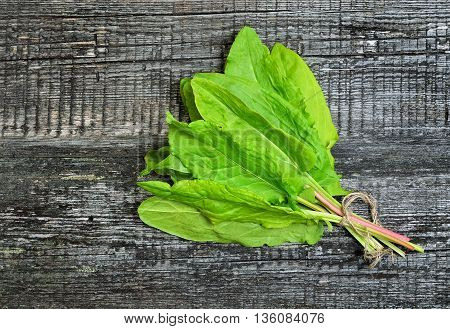 fresh sorrel on wooden background top view