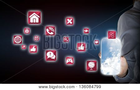 Hand holding smartphone and apps icons flying in air
