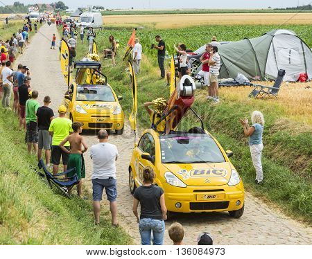 Quievy, France - July 07 2015: BIC caravan during the passing of the Publicity Caravan on a cobblestone road in the stage 4 of Le Tour de France on July 7 2015 in Quievy France. BIC is a global company which offers an extensive line of writing and office