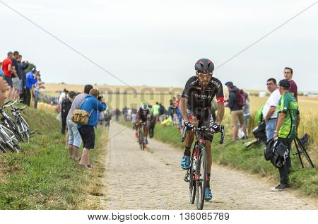 Quievy, France - July 07 2015: The Portuguese cyclist Jose Joao Mendes Pimenta Costa of Bora-Argon 18 Team inside the peloton riding on a cobblestoned road during the stage 4 of Le Tour de France 2015 in Quievy France on 07 July2015.