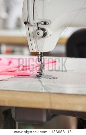 Fabric By Sewing Machine On Workbench