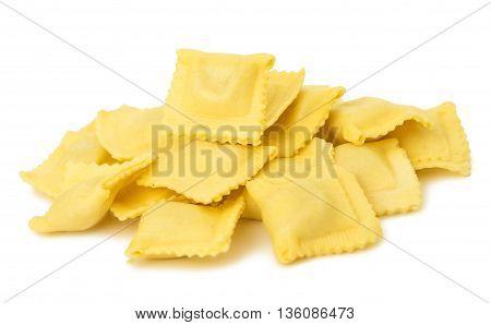 Ravioli pasta squares isolated over white background.