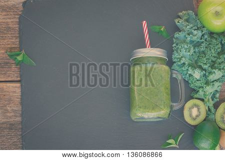 Fresh green smoothy drink with igredients with copy space, retro toned