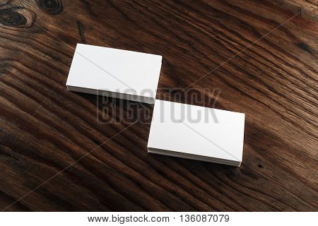Photo of blank business cards on a wooden table background. Template for ID. Mock-up for your design.