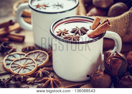 Mulled wine in mugs dry fruits and roasted chestnuts