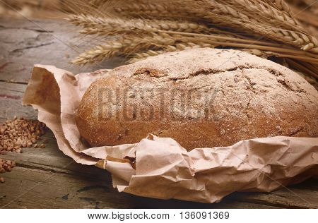 buckwheat bread on a wooden table. Country Still Life vintage filtered