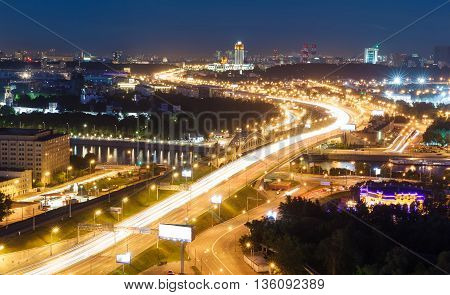 transport metropolis, traffic and blurry lights of cars on multi-lane highways and road junction at night in Moscow
