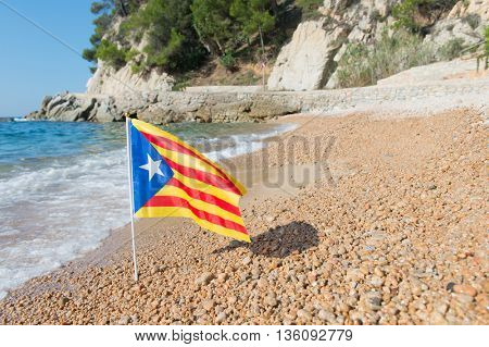 Catalan flag at beach in Catalunya