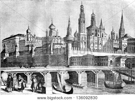 View of the Kremlin and the wooden bridge in Moscow, vintage engraved illustration. Magasin Pittoresque 1836.