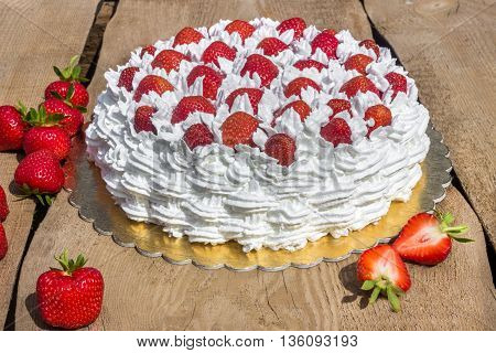 Light, delicate and tasty cream cake with fresh strawberries (half cake)