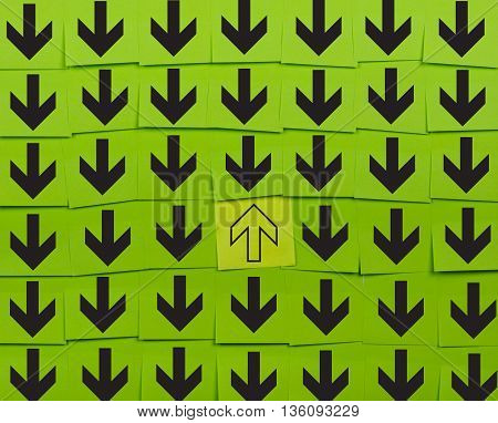Arrows. Opposite direction concept. Background of green sticky notes.