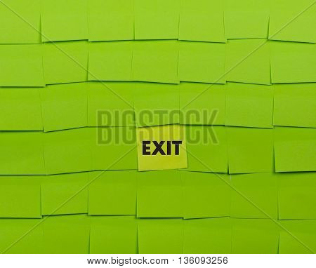 Exit concept. Background of green sticky notes.
