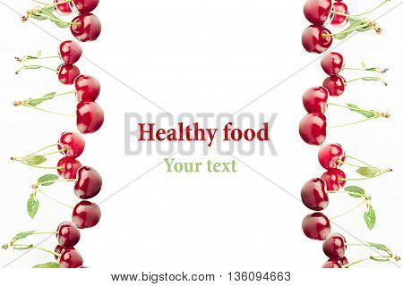 Framing of bunches of ripe juicy cherries on a white background. Isolated. Decorative fruit frame. Fruit background. Copy space.