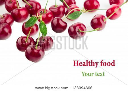 Scattered glossy cherry with tails on a white background. Isolated. Fruit border. Food background. Copy space.