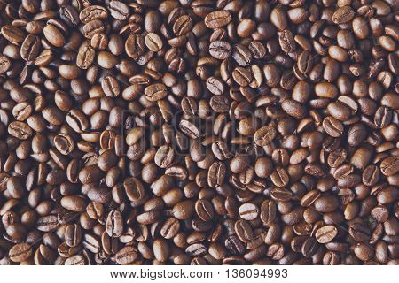 Coffee Beans background, arabika crop texture. Robusta seeds closeup pattern. Top view, soft color toning