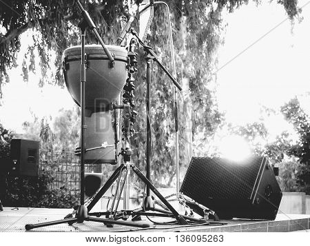 timbales percussion instrument on stage at sunset black and white