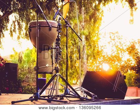 timbales percussion instrument on stage at sunset