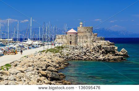 Colorful sunny day in the Mandraki harbor Rhodes, Greece