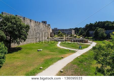 Fortifications of the Old Town of Rhodes - view of moat and walls, Italy tower on the right, Greece