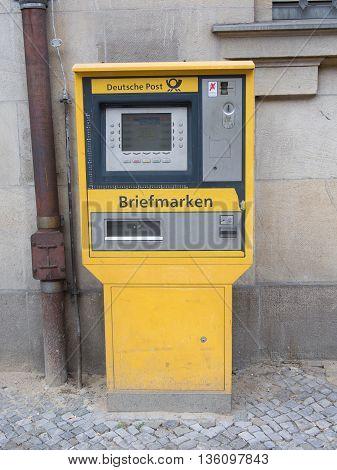 BERLIN GERMANY - JUNE 20 2016: old yellow stamp-machine German post