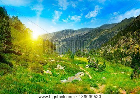 Beautiful sunrise in high mountains and blue sky