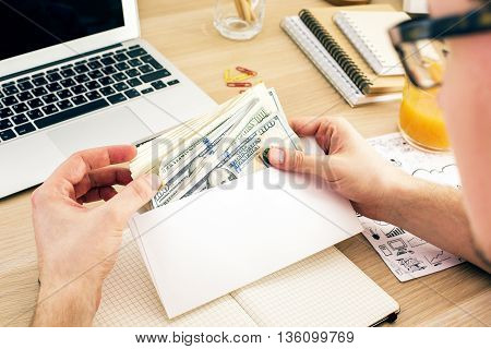 Man Holding Envelope With Money