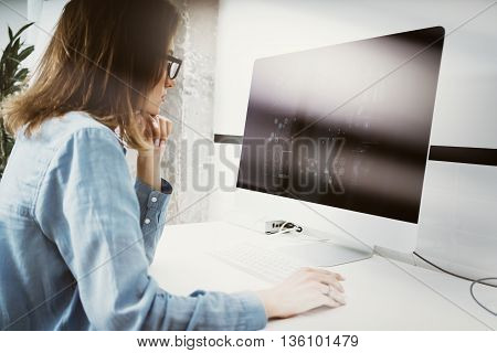 Woman Working Modern Desktop Monitor Hand Use Mouse.Account Manager Researching Process.Business Team New Startup Loft Office.HiTech Digital Diagrams Interface Screen.Analyze market stock.Blurred