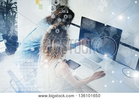 Coworkers Working Modern Desktop Monitor Wood Table.Bank Managers Researching Process.Business Team New Startup Loft Office.Virtual Digital Diagrams Interfaces Concept.Analyze market stock.Blurred