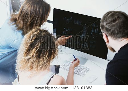 Coworkers Team Working Office Startup.Business Crew work Modern Desktop Monitor Wood Table.Bank Managers Market Research Process.Virtual Digital Diagram Screen.Interface Concept.Analyze stocks.Blurred