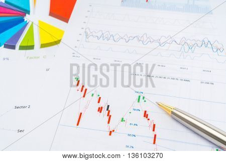 Financial charts with pen
