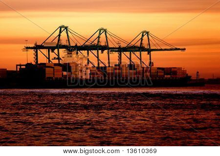 Cargo ship at sunset time in beautiful colours