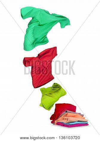 clothes fly out of pile on white background