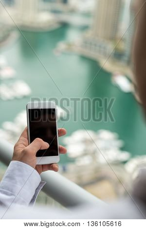 Close up of a man using a mobile phone.