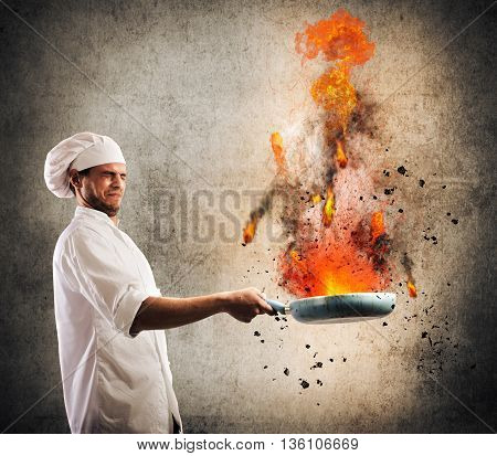 Bumbling chef holds a pan on fire