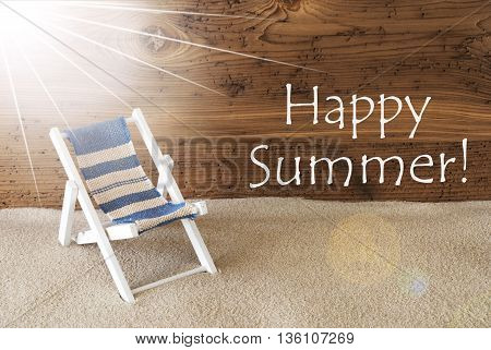 Sunny Summer Greeting Card With Sand And Aged Wooden Background. English Text Happy Summer. Deck Chair For Holiday Or Vacation Feeling.